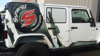 Partial Vehicle Wrap including Perforated Window Vinyl for Synergy Mfg., Poly Performance