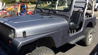 Gray Carbon Fiber Full Wrap on a Jeep